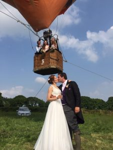 wedding in front of tethered balloon