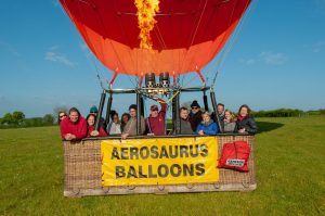 a family photographed in an aerosaurus balloon